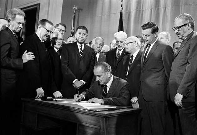 President Johnson signs Fair Housing Act on April 11, 1968